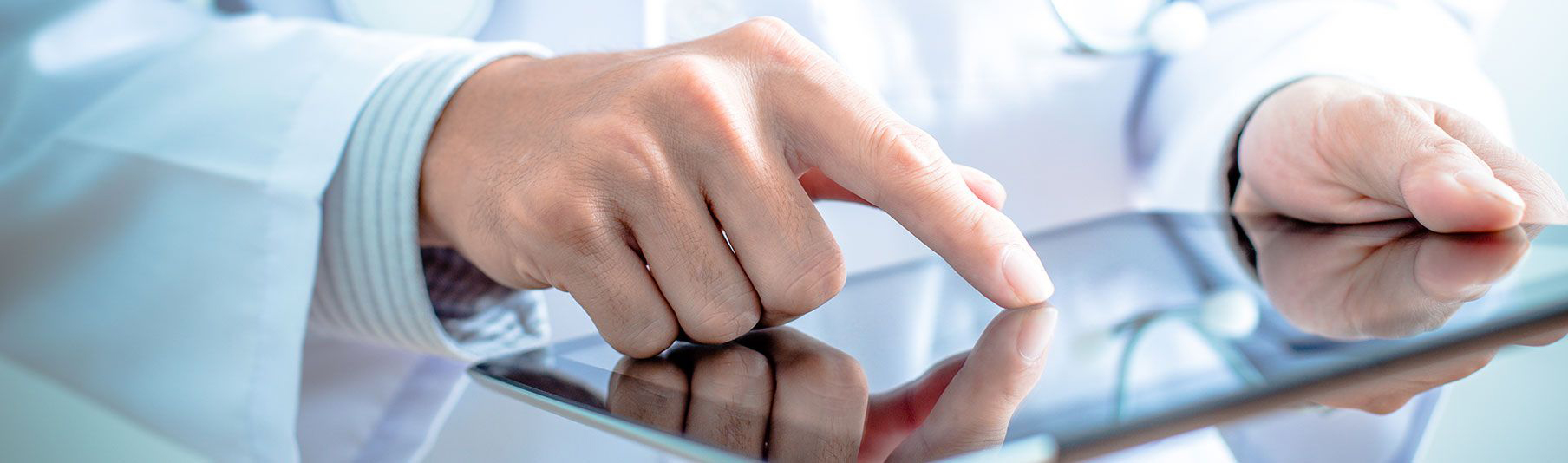 Key Locum Insurance Covers: Close-up of a doctor's hand using a tablet